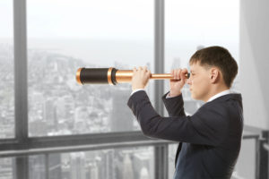 Business,Concept.,Businessman,Looks,Through,A,Telescope